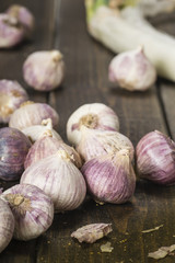 purple garlic on the wooden board