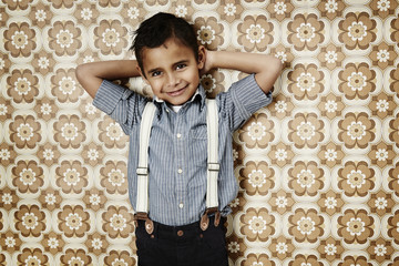 Confident young boy in braces