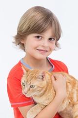 Portrait of cute boy holding cat
