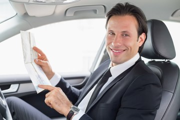 Businessman reading a map