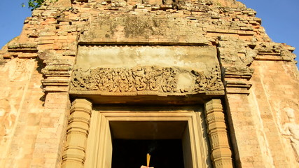 Pan Down - Female Buddhist Praying with Incense in Temple Doorway -   Angkor Wat Temple Cambodia