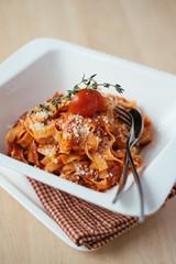 Homemade fettucine pasta with bolognese sauce