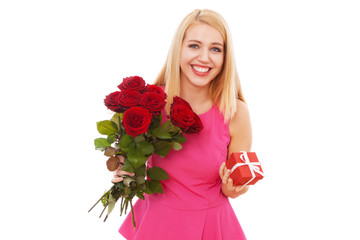 Young beautiful woman with a bouquet of roses