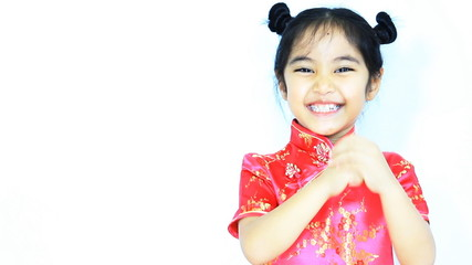 Happy little Asian Chinese child greeting, Chinese new year