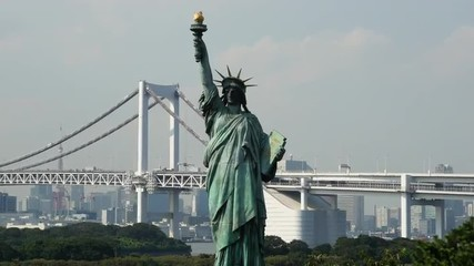 Replica Statue of Liberty with Peace Bridge in the Background  -  Tokyo Japan