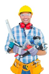 Portrait of smiling manual worker holding various tools