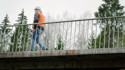 Engineer walking on the bridge