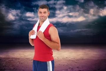 Composite image of fit man smiling at camera