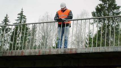 Engineer with documentation on the bridge