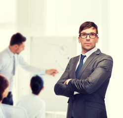 attractive buisnessman or teacher in glasses