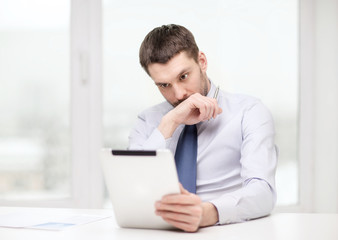 stressed businessman with tablet pc and documents