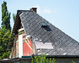 Ruined and demolished house roof