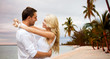 happy couple hugging over beach background
