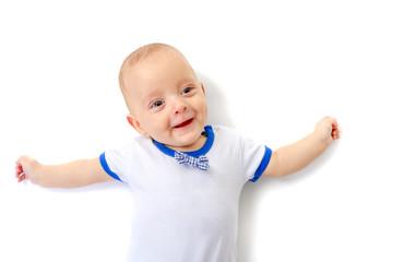 Baby boy smiling lying on white floor