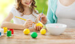 close up of family coloring easter eggs