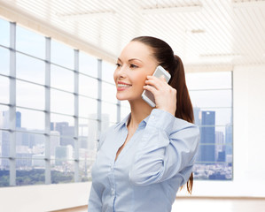 smiling businesswoman with smartphone