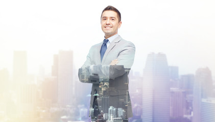 happy smiling businessman in suit