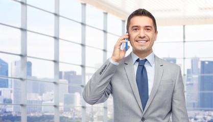 happy businessman calling on smartphone