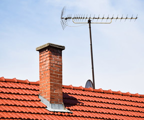 House roof with smoke stack and antenna