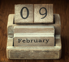 A very old wooden vintage calendar showing the date 9th February