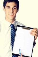 Businessman showing clipboard