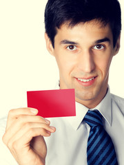 Businessman giving blank red card