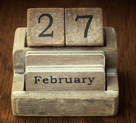 A very old wooden vintage calendar showing the date 27th Februar