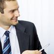 Businessman, giving pen