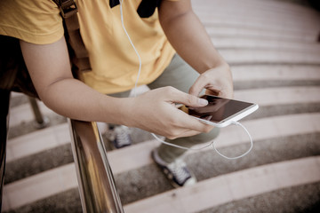 students sitting on stairs with their smartphones