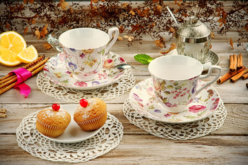 Vintage cups with muffins and cookies