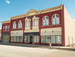 Ornate downtown storefronts Midwest small town - 78844511