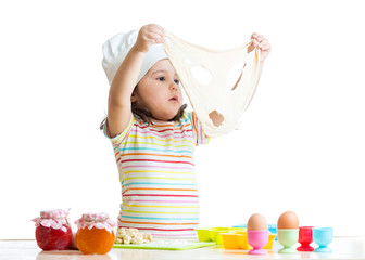 child girl playing with dough and flour