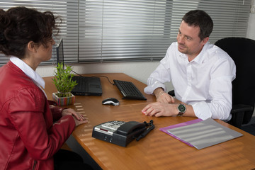 Happy Businessman And Businesswoman Discussing In Office