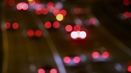 Very blurred night traffic scene with rear view
