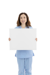 Female doctor or nurse showing a blank poster
