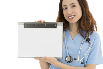 Nurse or doctor holding a blank clipboard for advertisement