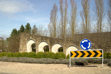 road signs in stone wall