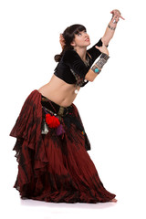 Trible belly dancer posing with hands.