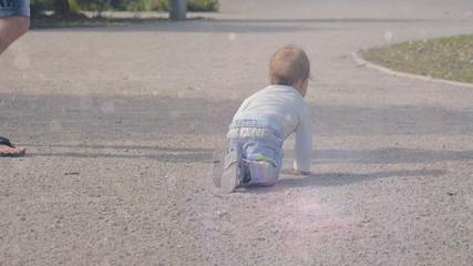 Baby boy crawling on the ground. Slowdown
