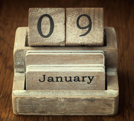 A very old wooden vintage calendar showing the date 9th January