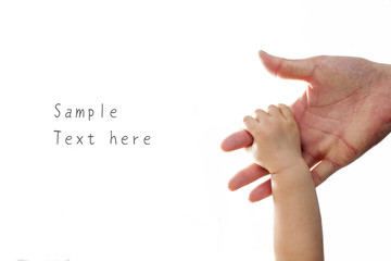 The parent's hand holds on one year old baby's hand