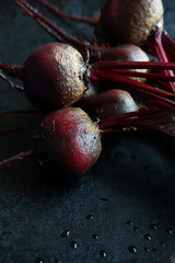 Armful of beets on a baking sheet