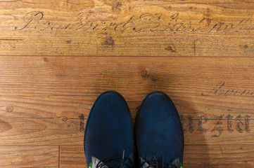 hipster leather man shoes view from above on wood floor