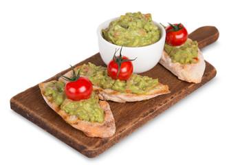 Guacamole with bread and avocado