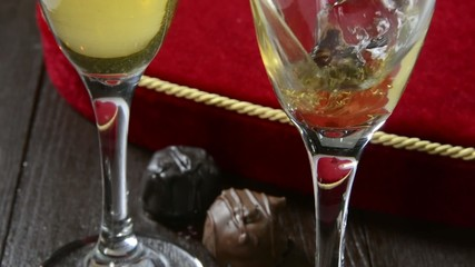 Champagne being poured with chocolates