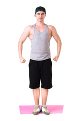 Full length portrait of a fit young man over white background