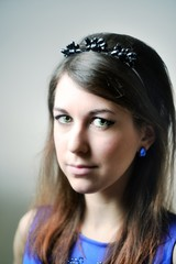 Portrait of young beautiful woman with headband