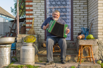 Ukrainian peasant playing button accordion