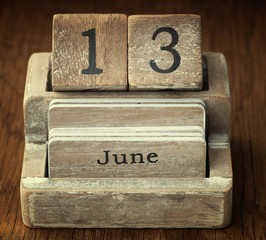 A very old wooden vintage calendar showing the date 13th June on