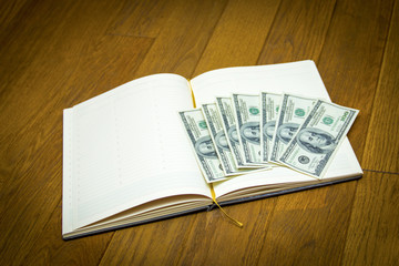 notebook pen money